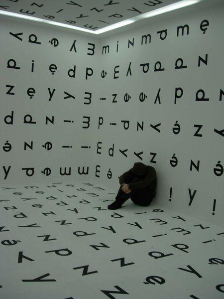 Visiting art museum in Warszawa, Bronek doing like Keith Haring, work of Stanisław Dróżdż
