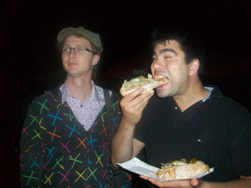 Julien eating a nice big typical Polish bread on a fair.