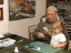 Zuza (Bronek\'s niece) and her Grandpa Marek play tossing old coins